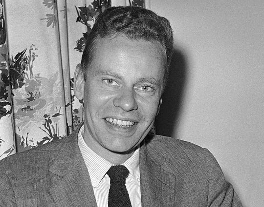 This Oct. 14, 1959 file photo shows Charles Van Doren at New York's hotel Roosevelt. Van Doren, who admitted his television quiz show performances in the 1950s had been rigged, died on Tuesday, April 9, 2019, in Canaan, Conn.