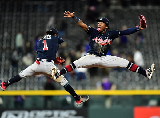 April 9: Atlanta Braves second baseman Ozzie Albies (1) and left fielder Ronald Acuna Jr. celebrate after defeating the Colorado Rockies, 7-1, at Coors Field.