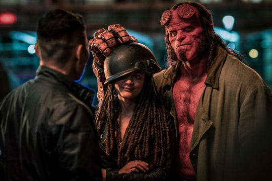 "Ben Daimio (Daniel Dae Kim, far left) teams with Alice Monaghan (Sasha Lane) and Hellboy (David Harbour) to take on monsters in ""Hellboy."""