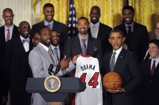 0b3fc52a255 Dwayne Wade presents Barack Obama with a jersey during the Miami Heat's  trip to the White