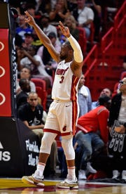 Dwyane Wade salutes the crowd.