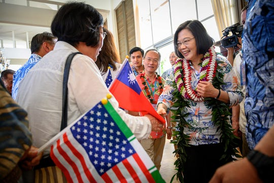 Taiwanese President Tsai Ing-wen, right, arrives in Hawaii on March 27, 2019.