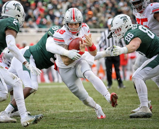 Ohio State quarterback Tate Martell (18) runs the ball during the second half against Michigan State in 2018.