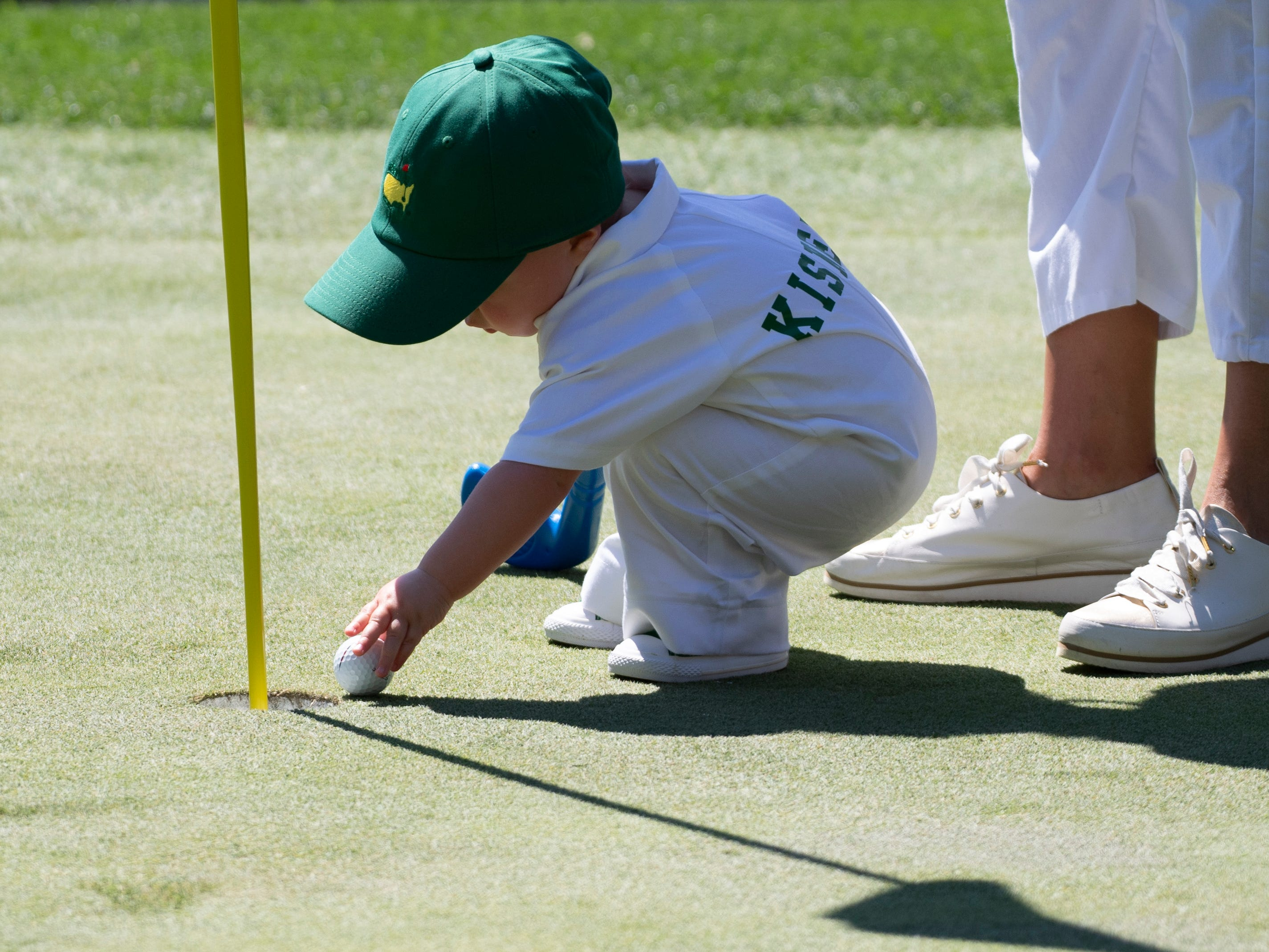 Kevin Kisner's son Henry James sets up his putt at the fourth green.