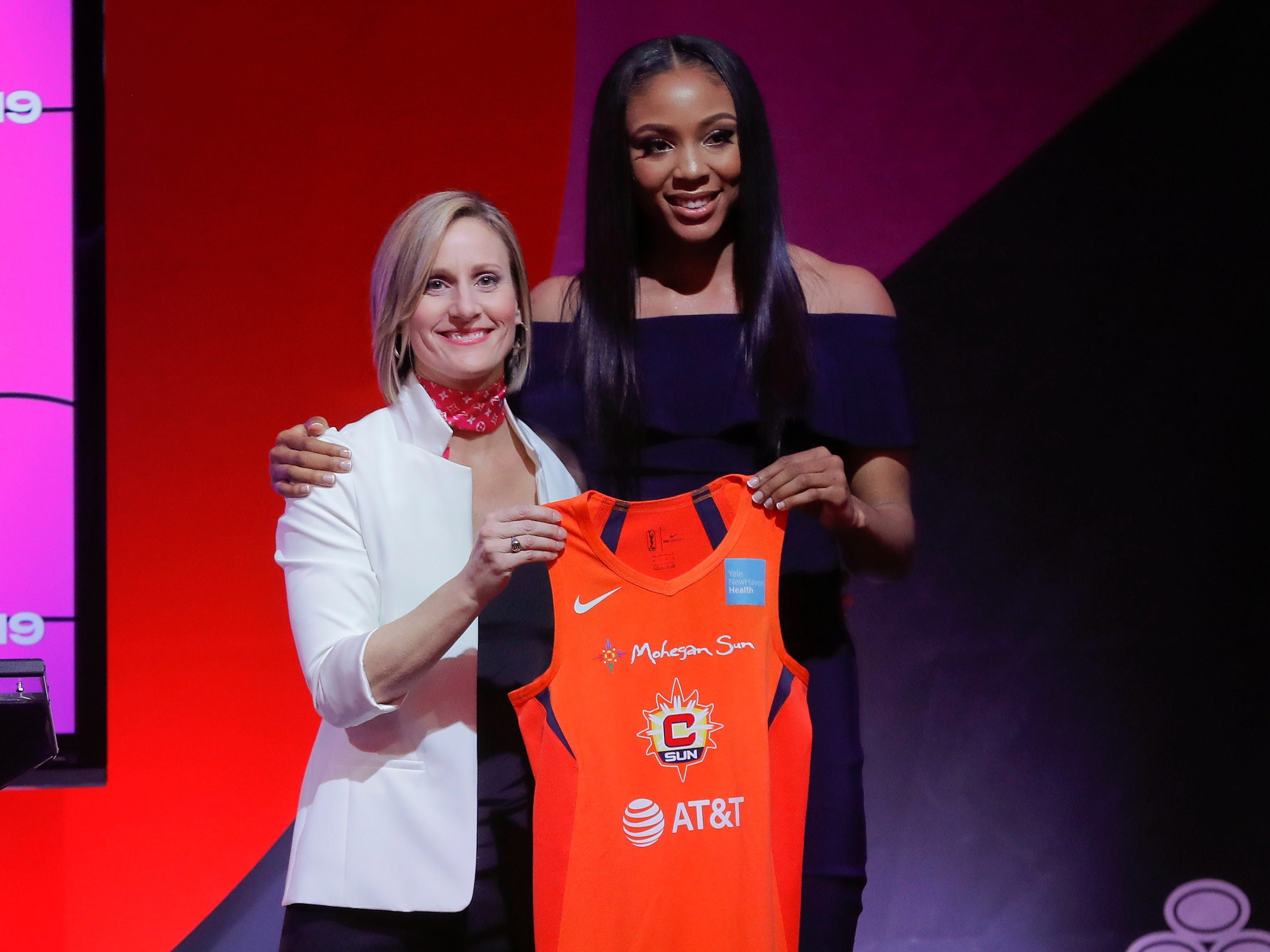 Kristine Anigwe poses for a photo with WNBA COO Christy Hedgpeth after being selected by the Connecticut Sun as the ninth overall pick in the WNBA draft.