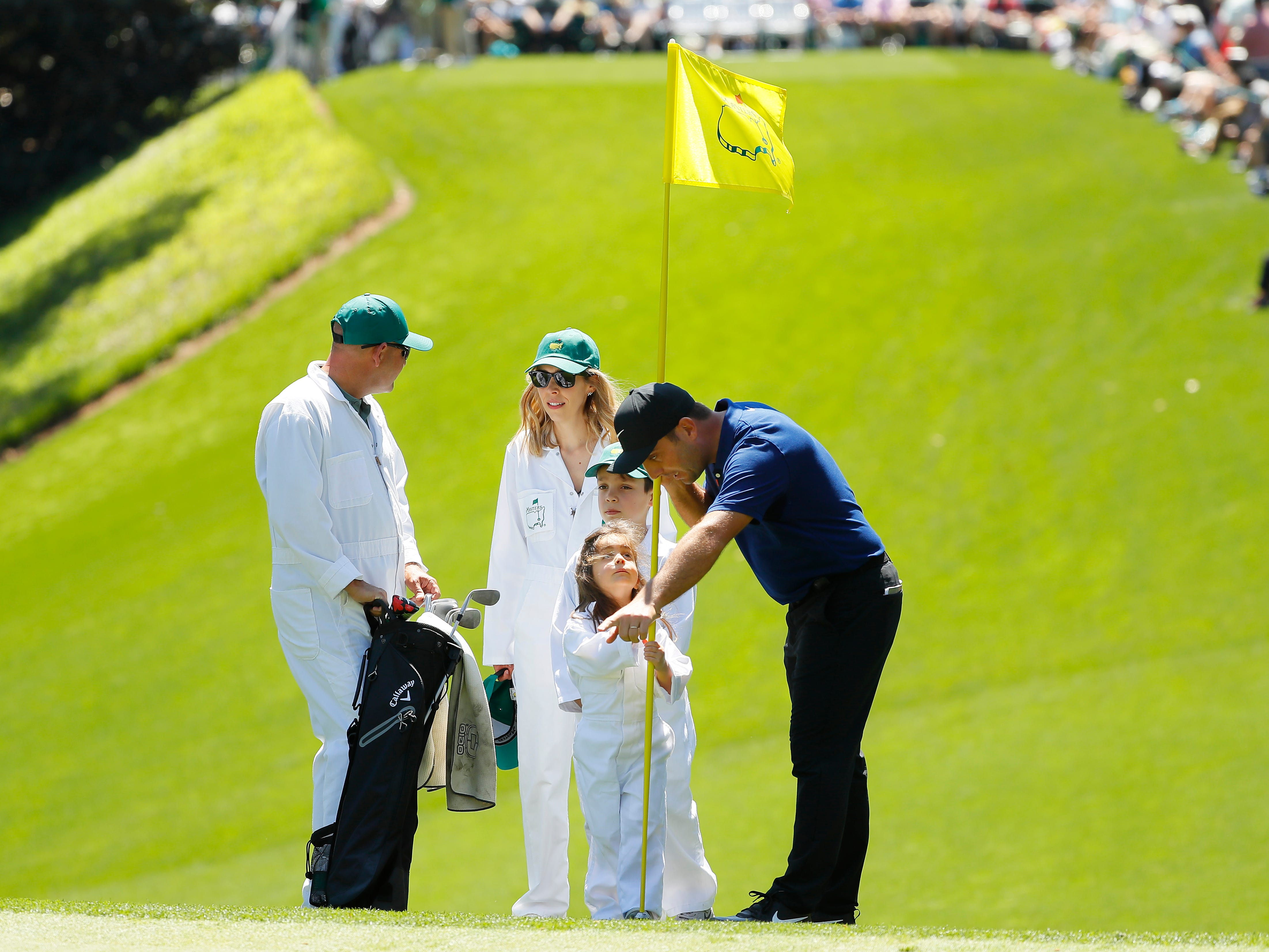 Francesco Molinari stands with his wife Valentina and their children.