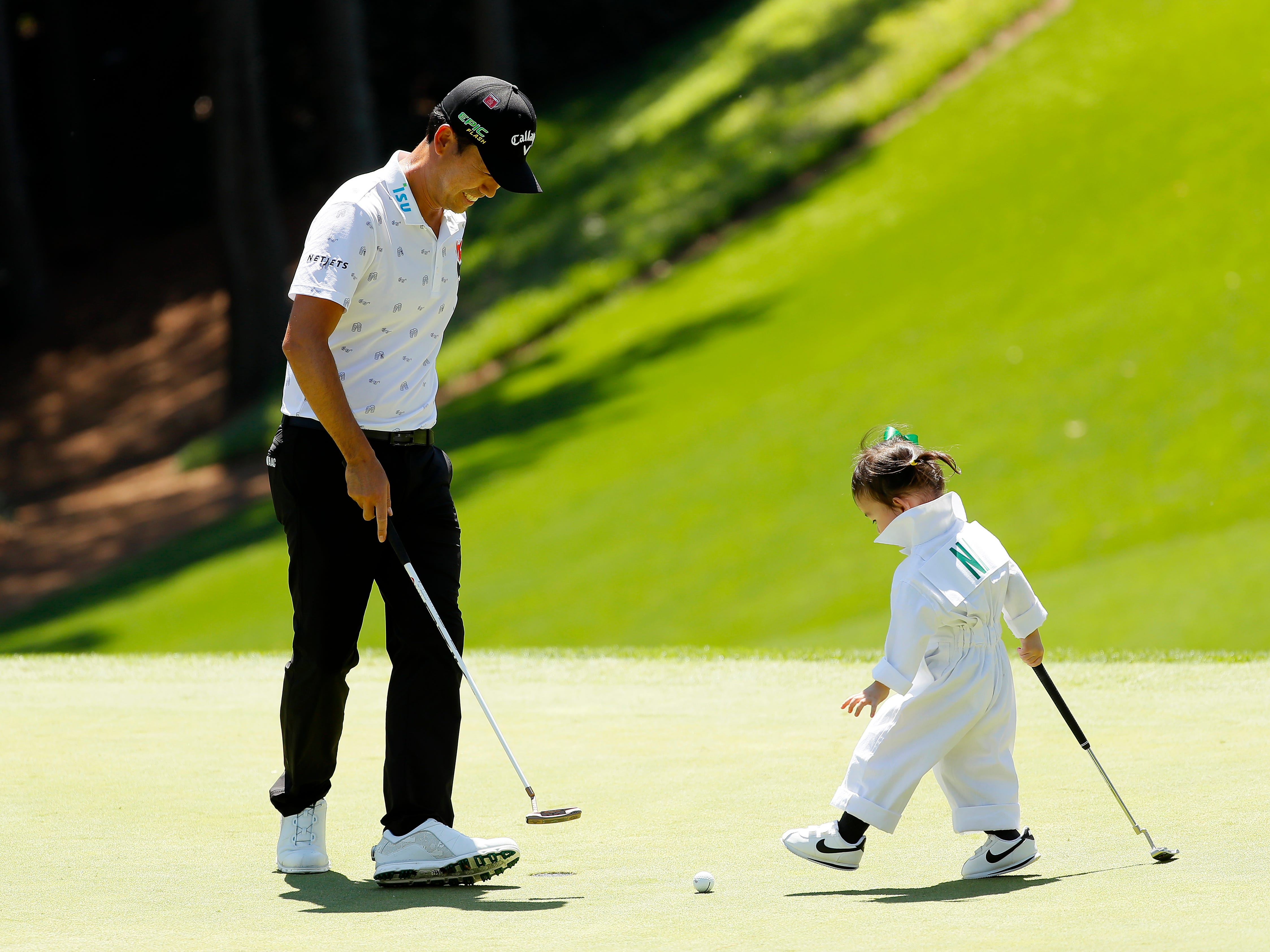 Kevin Na stands with his daughter Sophia.