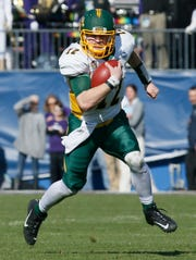 North Dakota State Bison quarterback Easton Stick (12) runs the ball against the James Madison Dukes in the second quarter at Toyota Stadium.