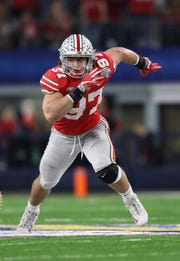 Ohio State Buckeyes defensive end Nick Bosa (97) rushes the passer against the Southern California Trojans during the fourth quarter in the 2017 Cotton Bowl at AT&T Stadium.