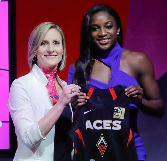 Notre Dame's Jackie Young poses for a photo with WNBA COO Cristi Hedgpeth after being selected as the No. 1 pick in the draft by the Las Vegas Aces.