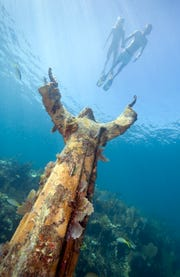 Christ of the Deep is a bronze statue situated about 25 feet under the sea in Key Largo, Florida.