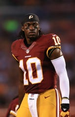 QB Robert Griffin III was offensive rookie of the year for the Redskins in 2012 before his career unraveled.