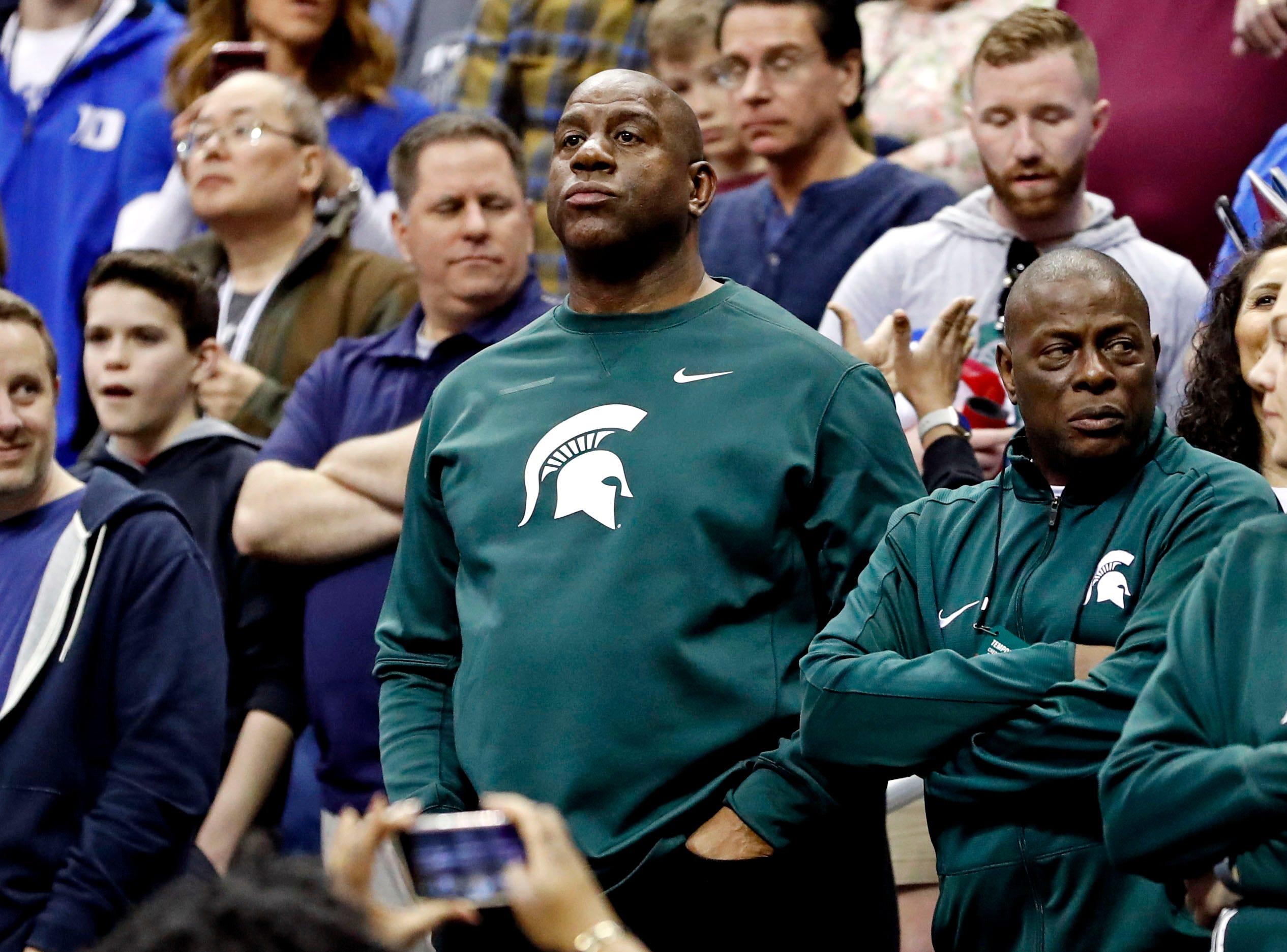 Magic Johnson watches Michigan State play against Duke during the 2019 NCAA Tournament.