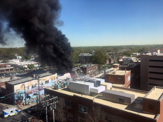 Smoke billows from the scene of an explosion and fire in downtown Durham, N.C. on April 10, 2019.