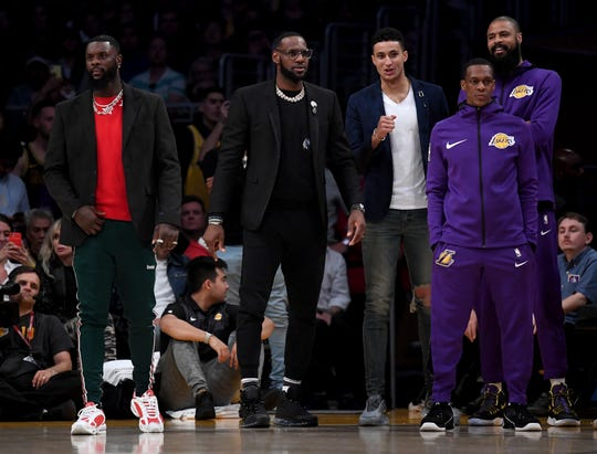 (Left to right): Lance Stephenson, LeBron James, Kyle Kuzma, Rajon Rondo and Tyson Chandler of the Los Angeles Lakers react to a play during a 104-101 loss to the Portland Trail Blazers at Staples Center on Wednesday.
