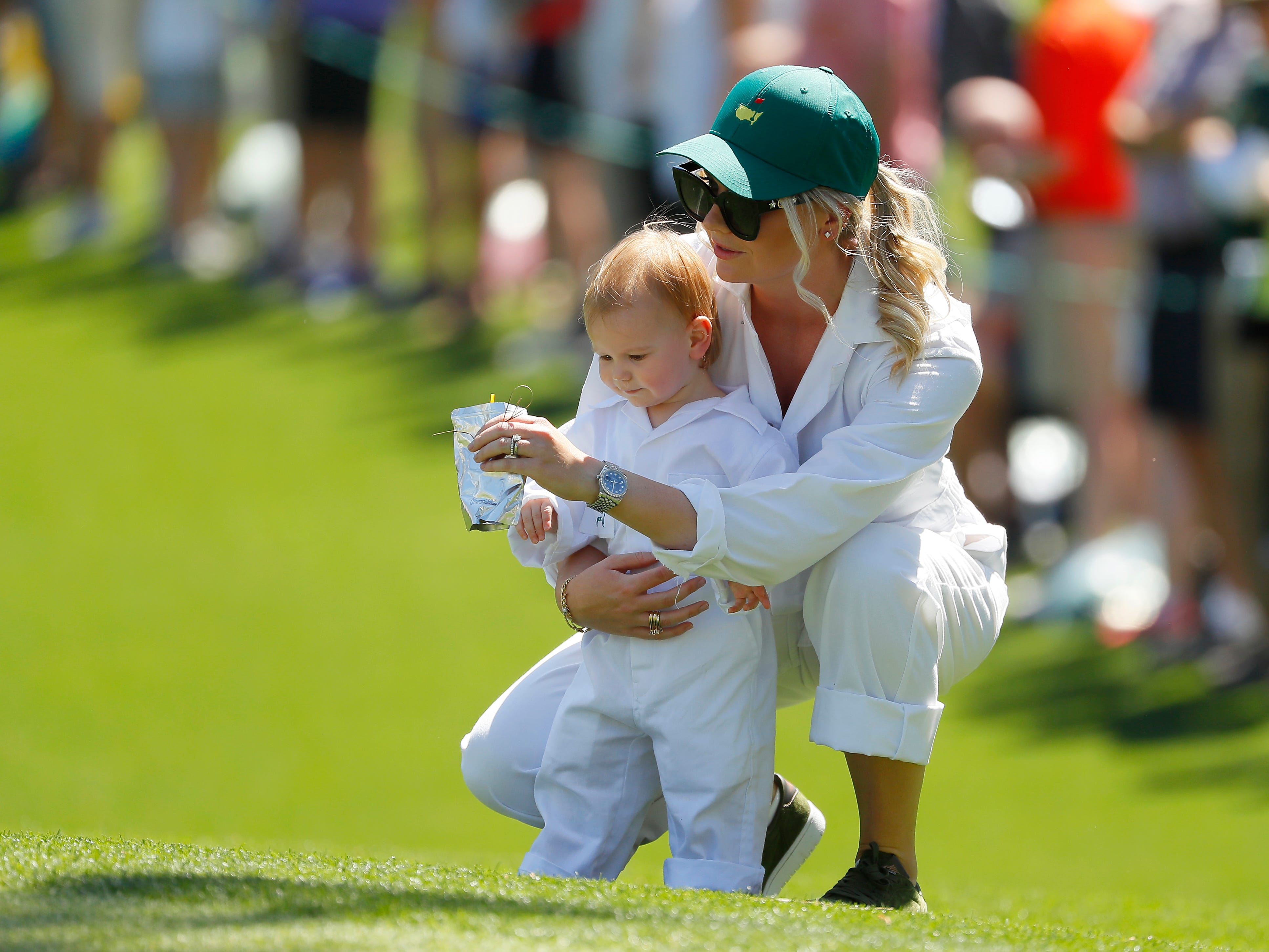 Henriette Friis, fiancee of Lucas Bjerregaard, looks on with their daughter Josephine.