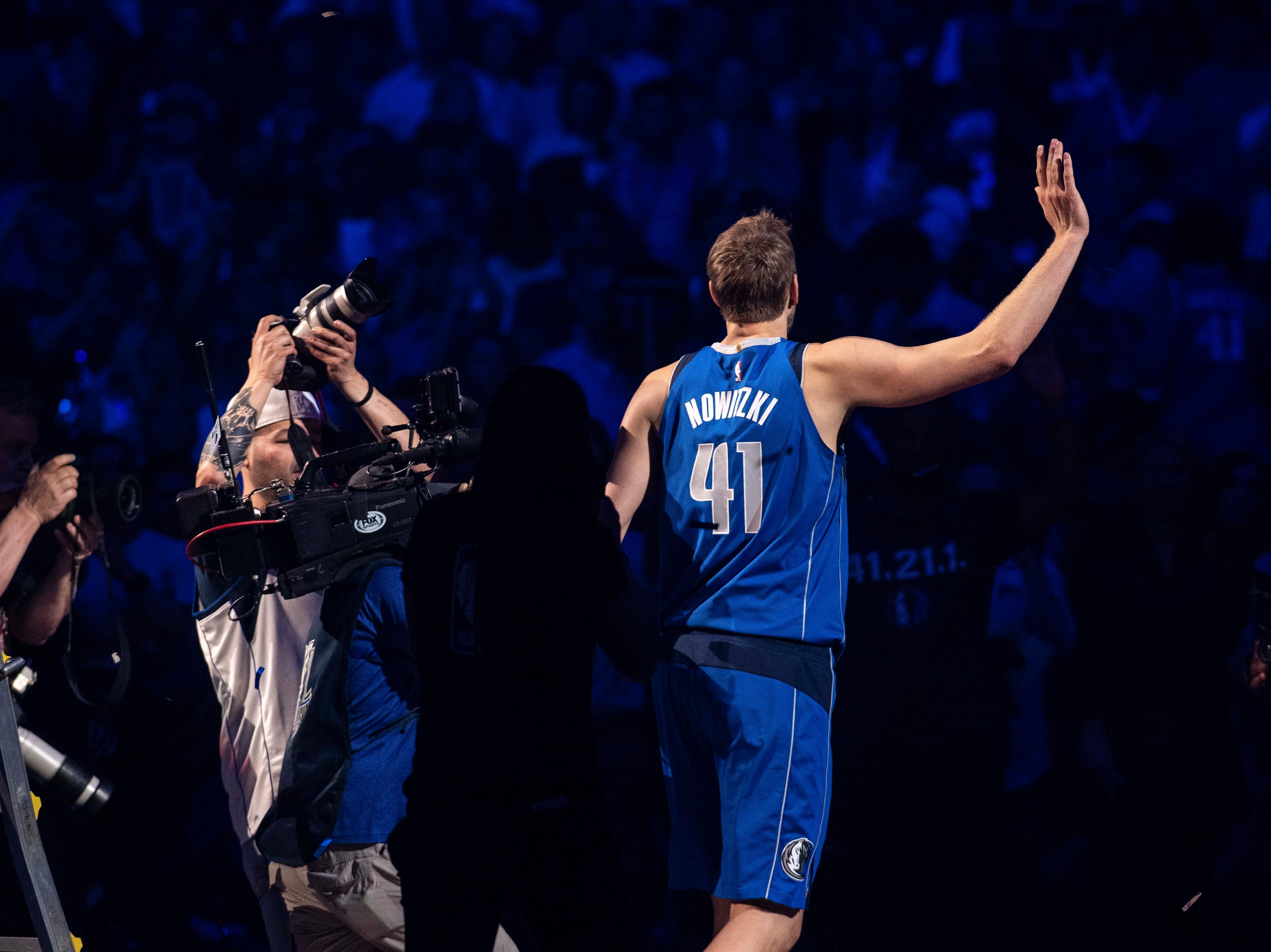 April 9: Dallas Mavericks forward Dirk Nowitzki walks off the court after announcing his retirement from the NBA.