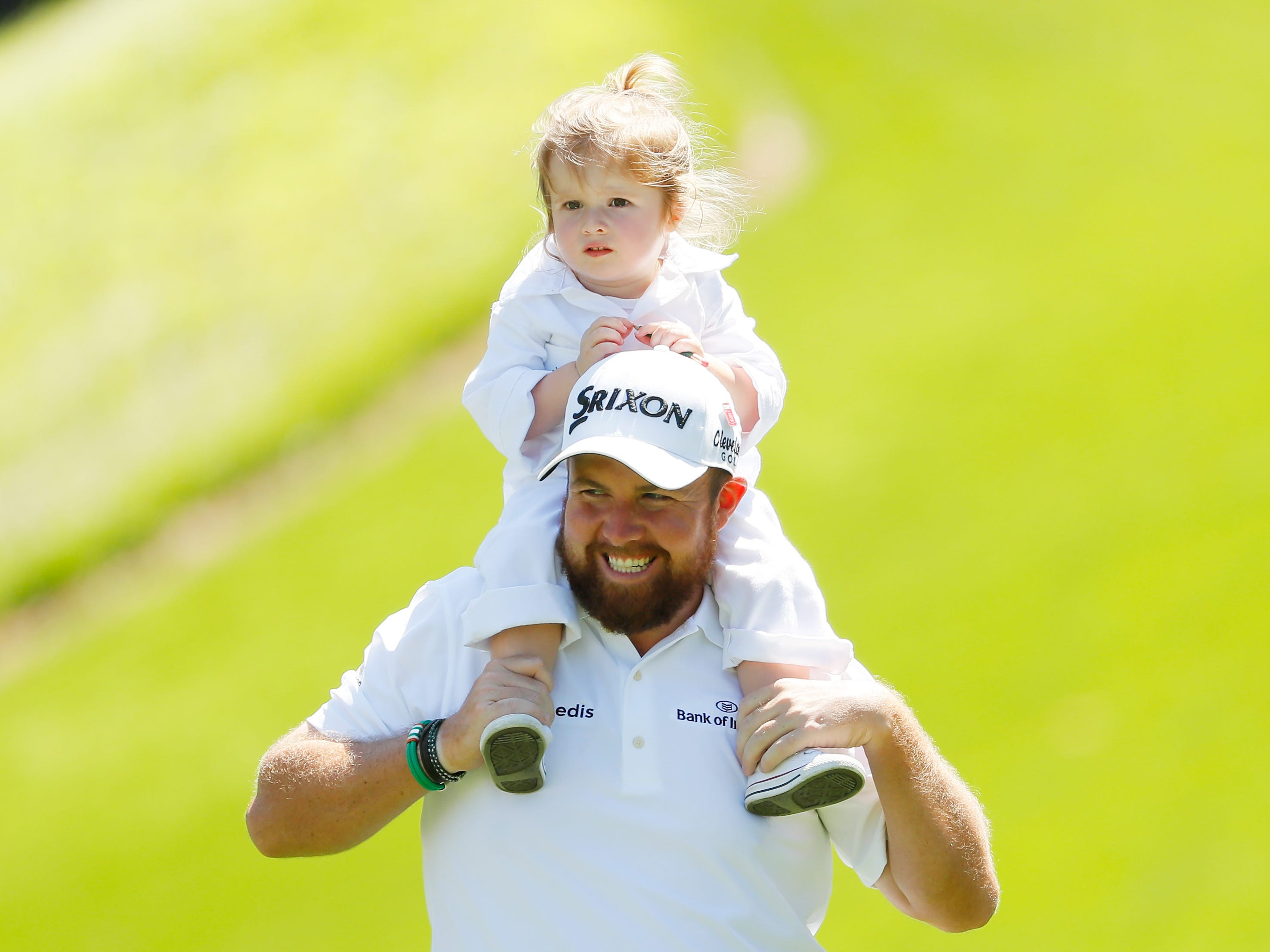 Shane Lowry carries his daughter Iris.