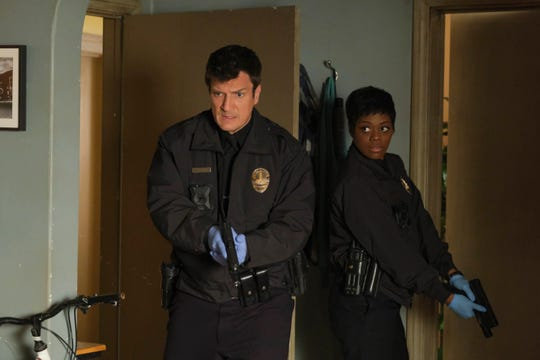 """Nathan Fillion stars as John Nolan, a 40-something LAPD trainee in ABC's """"The Rookie."""" Afton Williamson plays his  inscrutable training officer Talia Bishop."""