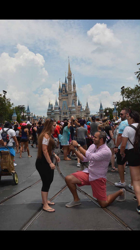 Miguel Morrobel proposed to wife Abby at in front of Cinderella's castle.