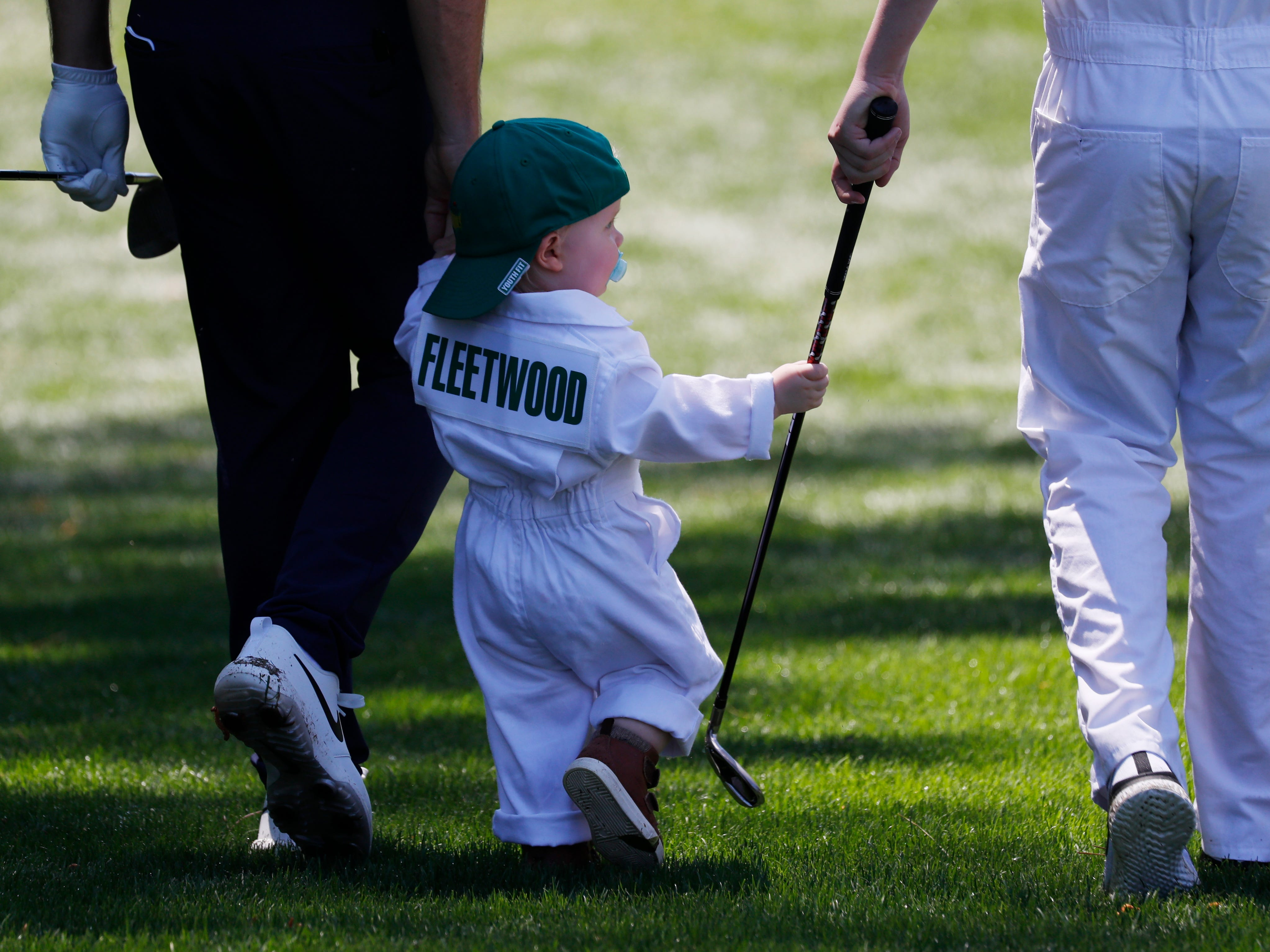 Tomy Fleetwood holds his son Franklin's hand.