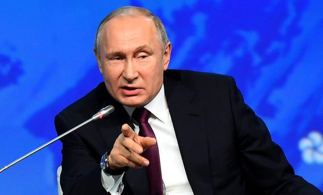 Russian President Vladimir Putin speaks during the International Arctic Forum in Saint Petersburg on April 9, 2019.