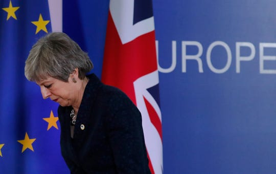 British Prime Minister Theresa May leaves after addressing a media conference at an EU summit in Brussels on March 22, 2019.