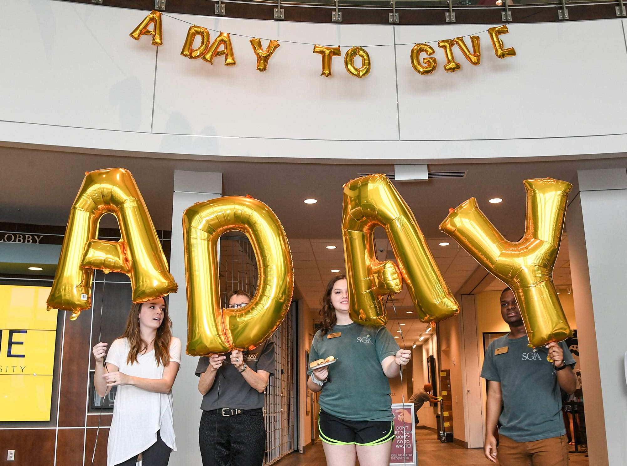 Anderson University students hold balloons spelling A Day  inside the G. Ross Anderson Student Center, during A Day to Give at Anderson University Thursday.  The 24-hour fundraising drive event is meant to give people from the school a chance to participate in events on campus to recognize the past, present, and future.