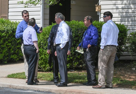 Anderson police investigators at the scene of a early morning death outside building K of Anderson Crossing Apartments in Anderson Thursday.