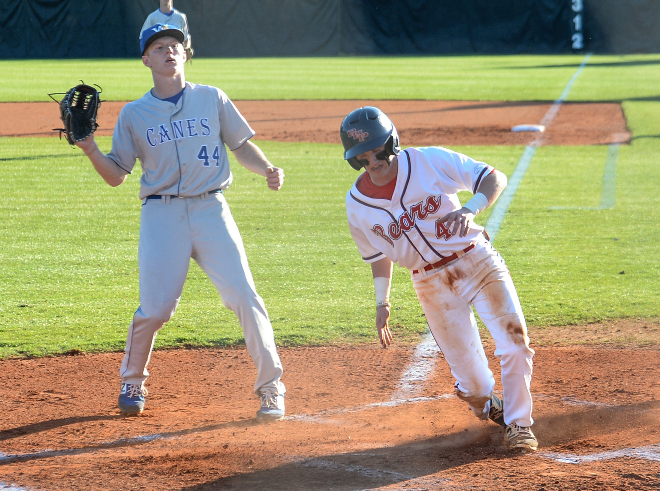 Belton-Honea Path sophomore Talmadge Lecroy (4) scores by Wren pitcher Carter Willis (44) during the bottom of the first inning at Belton-Honea Path High School in Honea Path Wednesday, April 10, 2019.