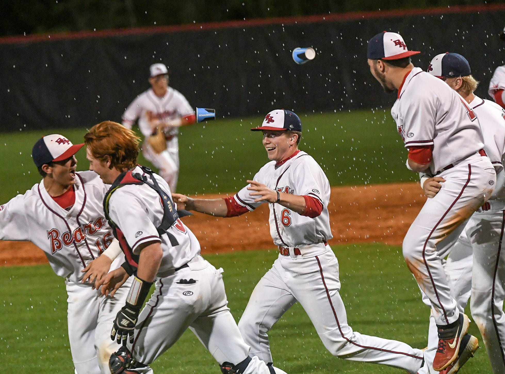Belton-Honea Path players celebrate a Class AAAA Region 1 title with a 7-5 win over Wren in Honea Path Wednesday, April 10, 2019.