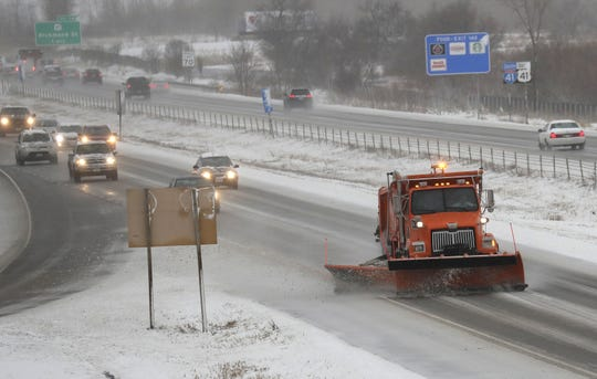 A plow clears snow for traffic traveling northbound on I-41 during a spring snow storm Thursday, April 11, 2019, in Appleton, Wis.