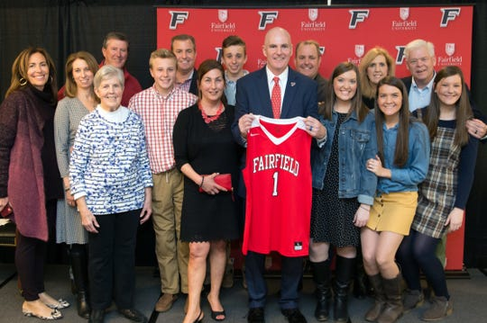 Jay Young poses with family members during his introduction as Fairfield's head coach.