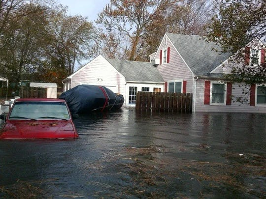 The outside of the Mura family home in Toms River after Sandy.