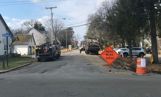 Crews install a curb on Sylvan Street in Lakewood on April 8, 2019.