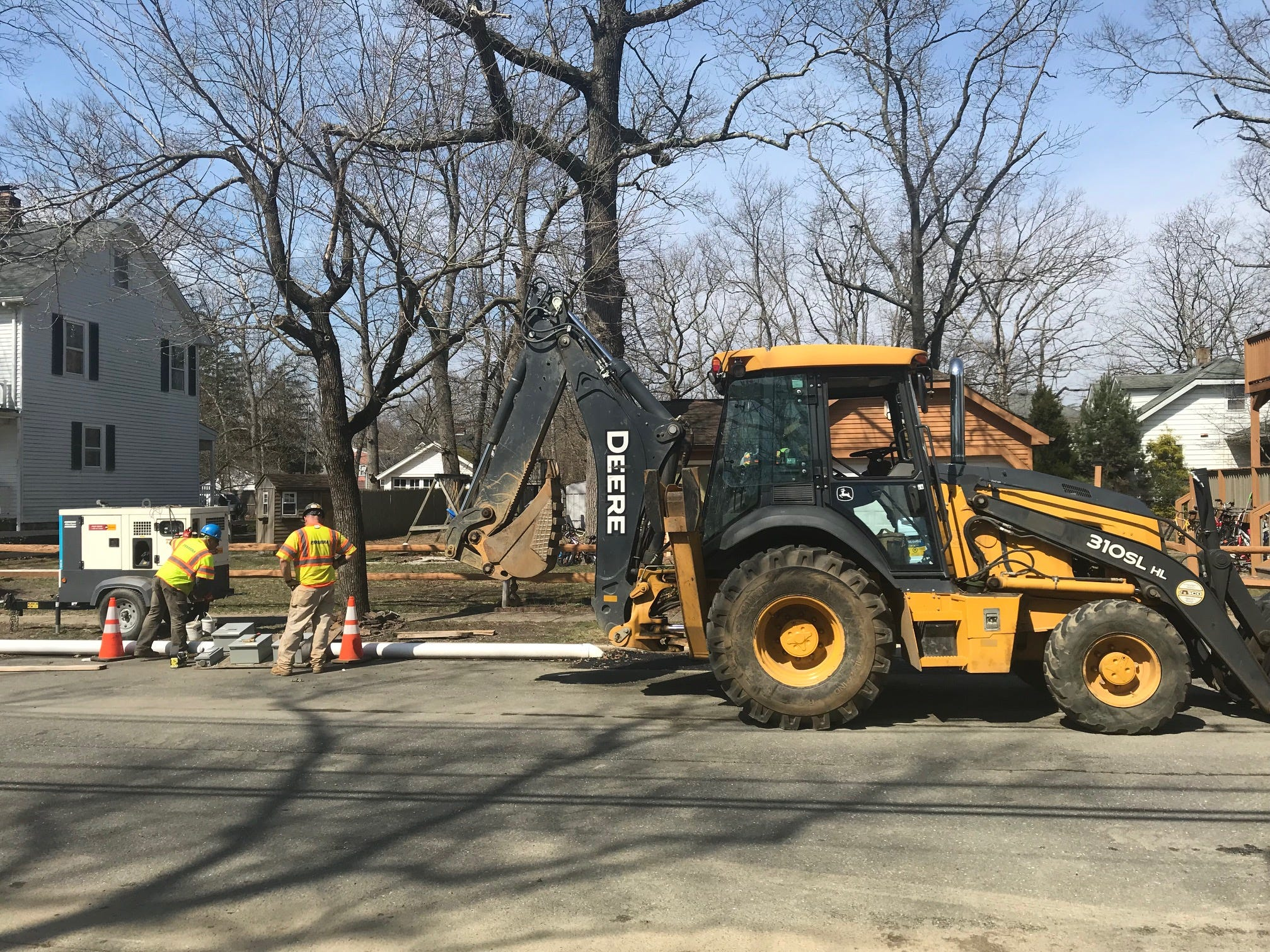Crews working on a drainage improvement project on Kimball Road in Lakewood on Monday, April 8, 2019.