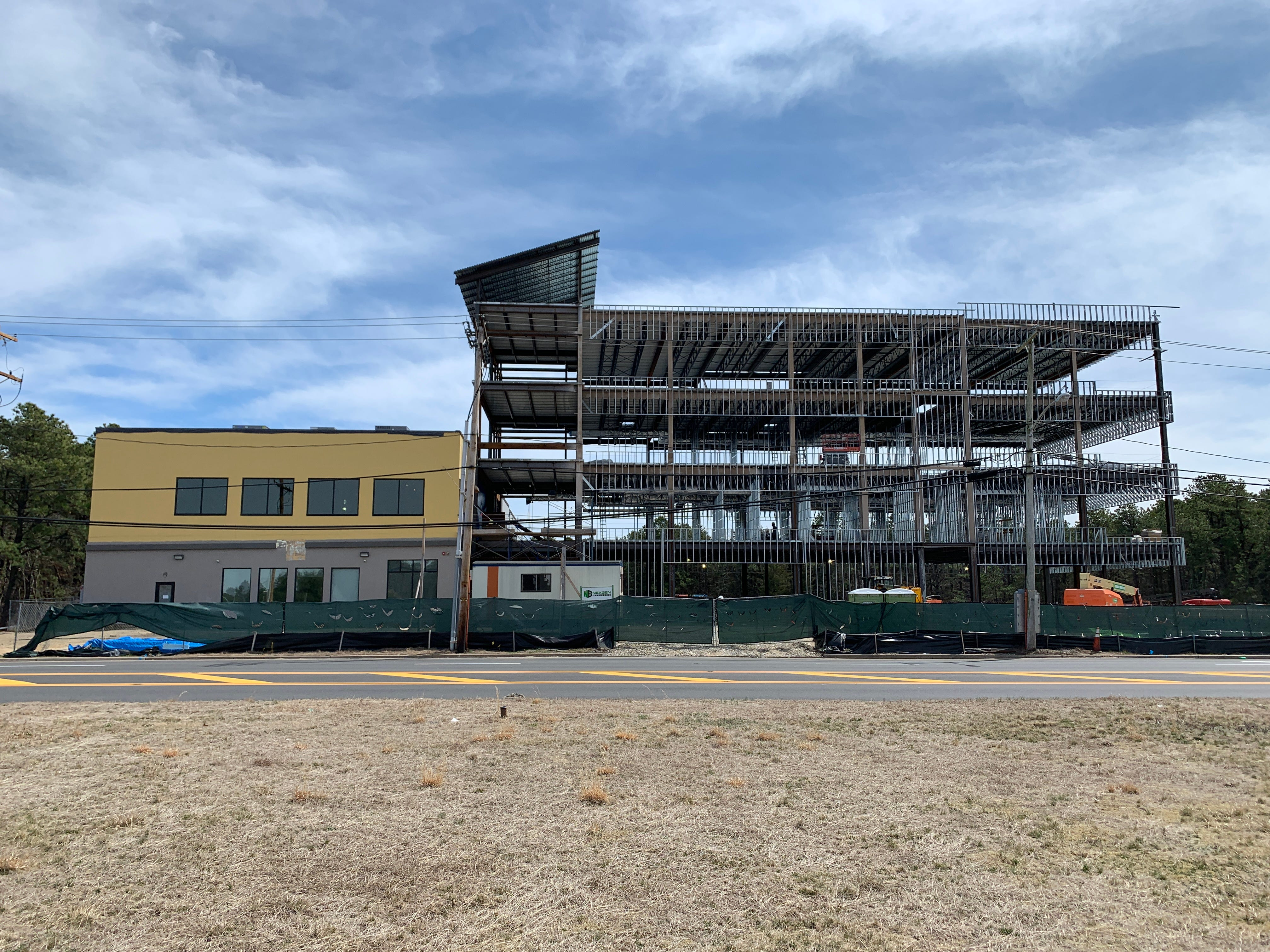 An addition to a small office building on Airport Road is under construction in the Lakewood Industrial Park.