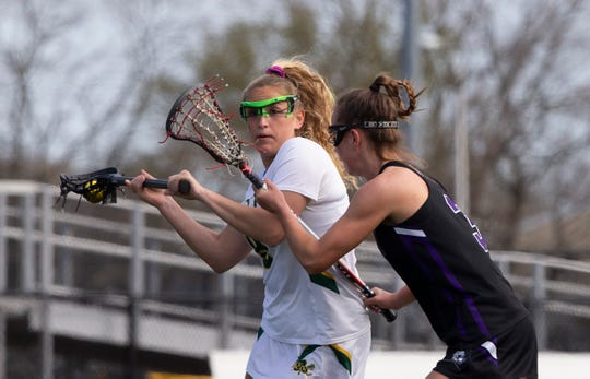 Red Bank Catholic's Abi George winds up and shots for her team's third goal. Rumson/Fair Haven Girls Lacrosse vs Red Bank Catholic in Red Bank, NJ, on April 12, 2019.