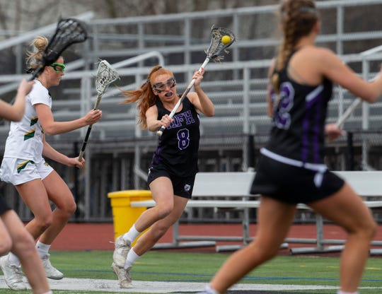 Rumson's Sophia Passalaqua tries to move the ball quickly down field during first half action. Rumson/Fair Haven Girls Lacrosse vs Red Bank Catholic in Red Bank, NJ, on April 12, 2019.