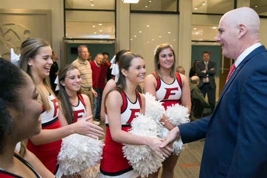 Jay Young greets Fairfield's cheerleaders