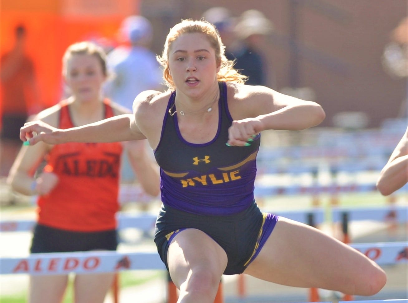 Wylie's Ambria Brekke clears a hurdle en route to winning the 100-meter hurdles at the District 4-5A track and field meet Thursday, April 3, 2019, at Aledo's Bearcat Stadium. She won the race in 16.91 seconds, while teammate Madison Latham was second (15.97).