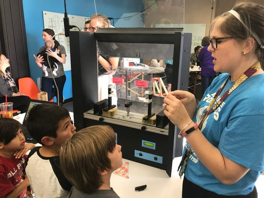ATEMS teacher Allison Stanley, right, teaches some young students about force and geometry while at Abilene Christian University Maker Lab's Maker Fest 2019 on Thursday. Stanley and other ATEMS representatives were at the Maker Lab in ACU's Brown Library to demonstrate robotics and other aspects of the ATEMS program.