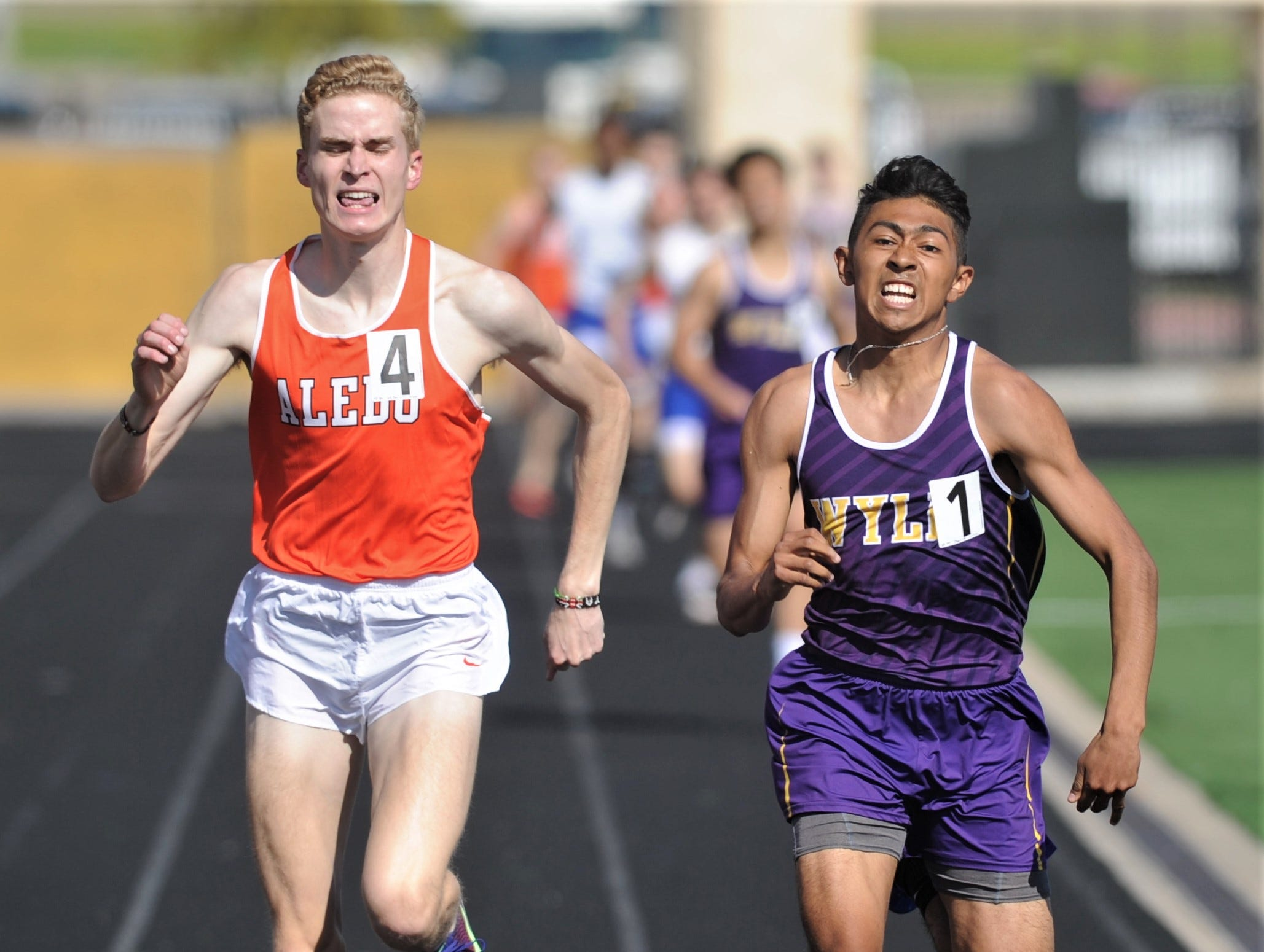 Wylie's Victor Charro, right, battles Aledo's Graydon Morris for the 800 meter title at the District 4-5A track and field meet on Thursday, April 3, 2019, at Aledo's Bearcat Stadium. Morris edged Charo for the title, running a 1:57.28 to Charo's 1:57.41.