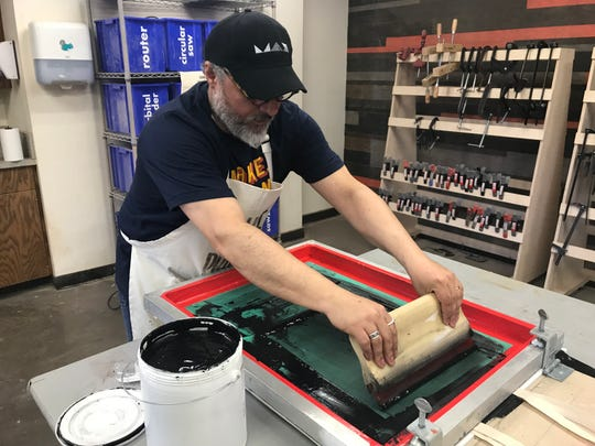 Abilene Christian University assistant professor Nil Santana uses a squeegee to screen-print a canvas tote bag Thursday at ACU Maker Lab's Maker Fest 2019. Santana is assistant director of the maker lab, which celebrated its fifth Maker Fest with the free, public event.