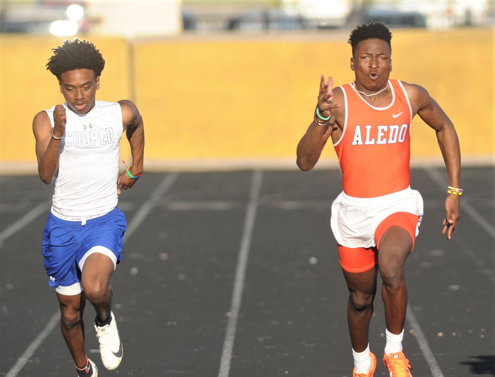 Cooper's Keitron Boyd, left, races Aledo's Monterren Parks to the finish line in the 200 meters final at the District 4-5A track and field meet Thursday, April 3, 2019, at Aledo's Bearcat Stadium. Parks won the race in 22.54 seconds, while Boyd was second (22.63).