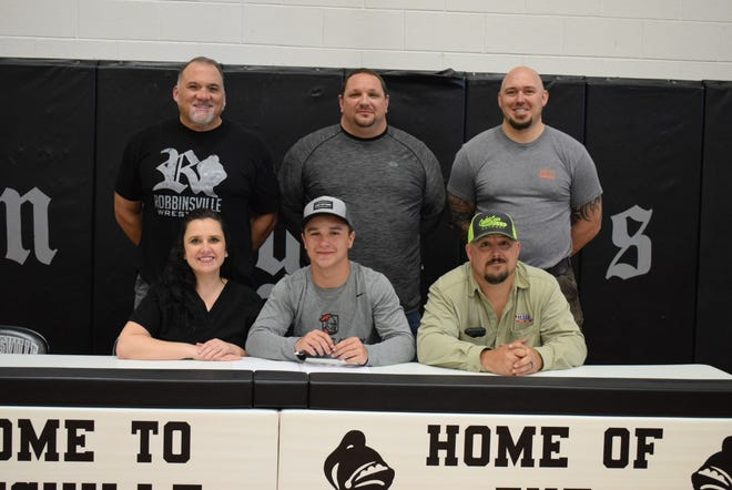 Robbinsville senior Kade Millsaps, a two-time state champion wrestler, signed with Belmont Abbey this week.