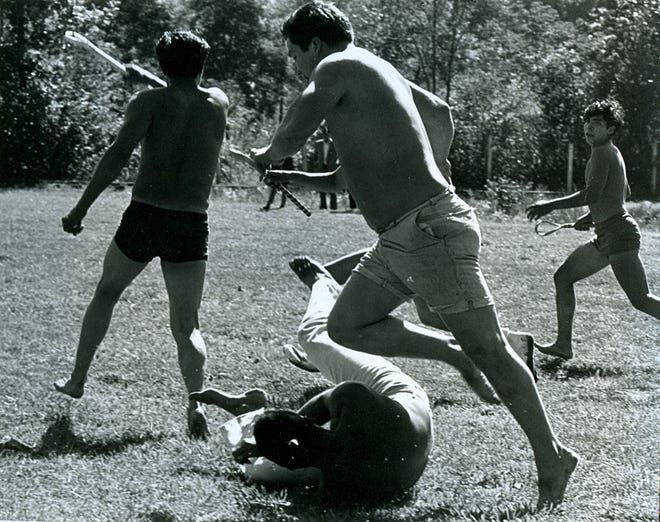 Big anesto, or stickball, exhibitions take place traditionally at the Cherokee Indian Fair Grounds at the beginning of October.  Here, players compete in the 1970s.