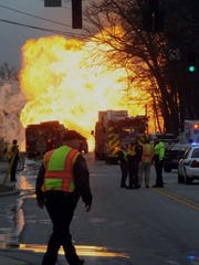 Emergency crews respond to a large fire caused by a ruptured gas line on Jan. 10, 2014 on Sand Hill Road.