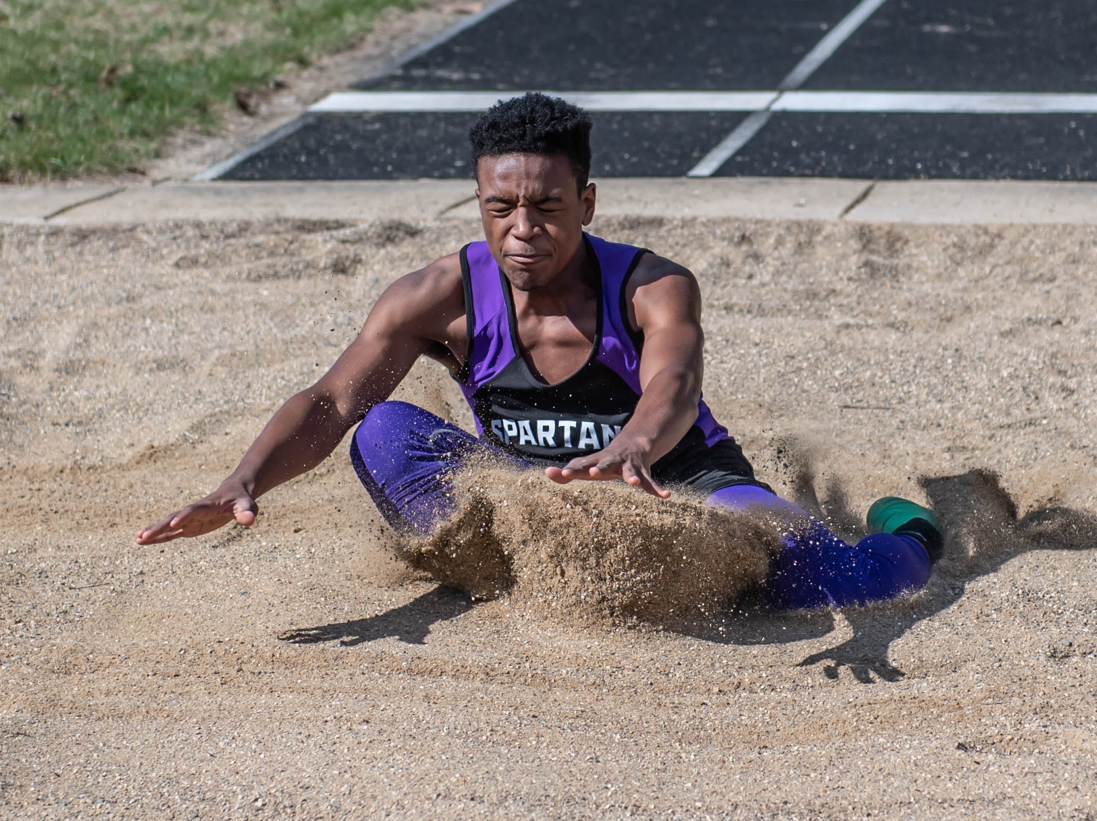 Lakeview's Elijah Smith competes in the long jump at Lakeview High School during a dual meet held on 4/9/19.