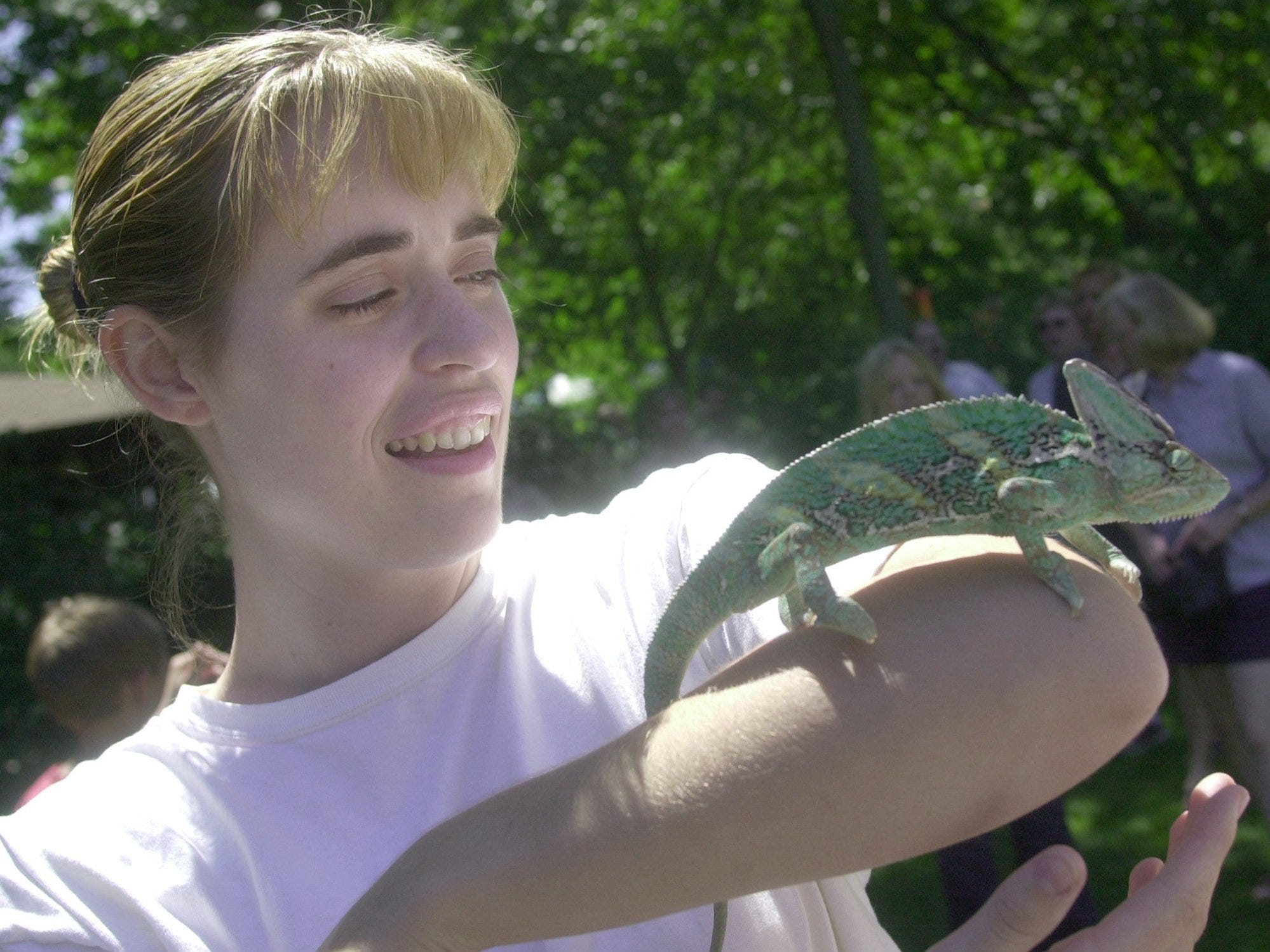 Faith DenHerder of Grandville holds Radar the chameleon in 2001